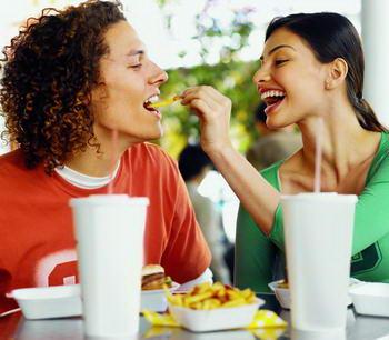 Девушка кормит парня